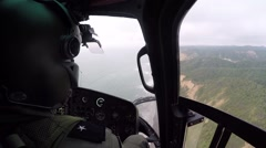 Copilot of a helicopter flying over the coast line of Ecuador - stock footage