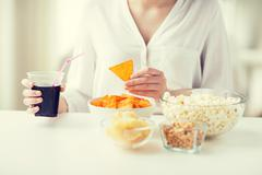 Close up of woman with junk food and coca cola cup Stock Photos