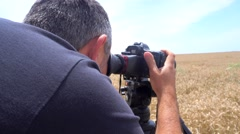 Photographer look through a loupe for DSLR Stock Footage