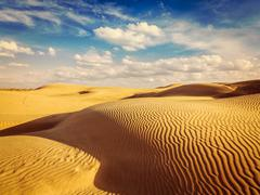 Sand dunes in desert - stock photo