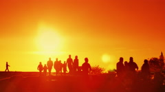 4K Orange Sunset with Silhouettes of Happy Family People in Park Together - stock footage