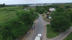Drone aerial scene following a truck heading to an import export harbour - stock footage