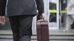 Business Man With Case While Commuting To Work Stock Footage