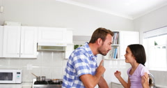 Father telling off his daughter on the kitchen Stock Footage