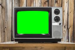Analog Television with Wood Wall and Croma Key Green Screen - stock photo