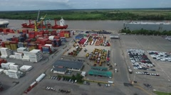 Drone scene over an import export harbour, Containers, cargo ship, cars and rive Stock Footage