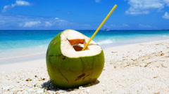 Ready to drink coconut at the tropical white sand beach - stock footage