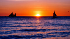 View of the tropical sea at sunset in pink/orange tones Stock Footage