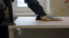 male worker using the jigsaw. Furniture assembly - stock footage