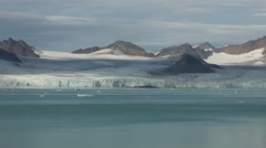 Sea mountains and large icebergs reflecting water. Stock Footage