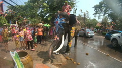 Thai elephants playing with people on street during Songkran Stock Footage