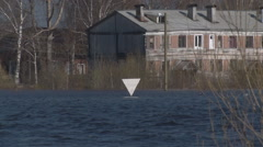 Big river in the North overflowed in the spring and flooded the village Stock Footage
