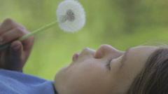Portrait of a boy with a flower dandelion. Stock Footage