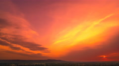 The flow of cloud over the city on the background of sunset. Time lapse Stock Footage