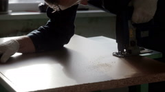 Male worker using the jigsaw. Furniture assembly Stock Footage