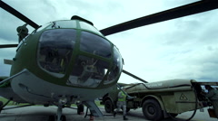 Military helicopter is loaded into the tank with jet fuel Stock Footage