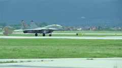 Russian fighter plane MiG-29 is moving on track after landing Stock Footage