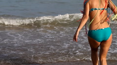 slender young girl on the coast - stock footage