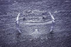 Protective goggles, plastic safety glasses for work Stock Photos
