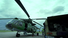 Military helicopter is loaded from a fuel tank Stock Footage