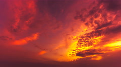 The flow of bright cloud against the sunset. Time lapse Stock Footage