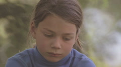 Boy with regret looking at the camera, then smiles. Face close up. Stock Footage
