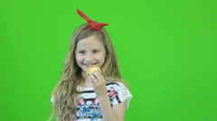 Girl eating cookies on chromakey Stock Footage