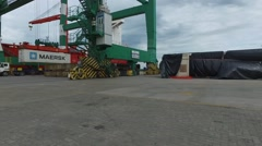 Drone aerial riverside scene flying between containers a huge crane and a cargo Stock Footage