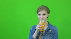 Chromakey footage girl drinking juice on a green background Stock Footage