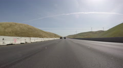 Freeway Windmills and Golden Hills in the Altamont Pass near Oakland Californ Stock Footage