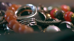 Modern designer jewelry from various materials of silver, gold, stone and glass Stock Footage