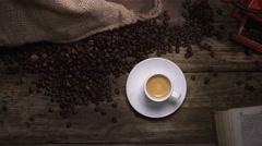 cup of coffee and coffe beans - stock footage
