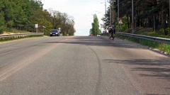 Kiev, Ukraine -Car riding through the forest to the sea - stock footage