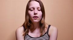 Sad depressed teen girl almost crying. 4K UHD - stock footage