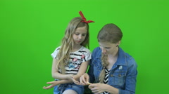 Chromakey footage Mother and daughter eat a tangerine on a green background - stock footage