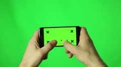 Man hands using a smart phone for write text messaging with chroma key, green Stock Footage