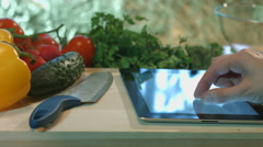 Man preparing salad vegetable dish and writes a prescription for a tablet comput Stock Footage