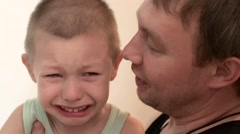 Child crying in front of his father  Stock Footage