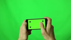 An iPhone With Green-Screen is used by a Man Arkistovideo