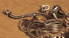 Silver chain and designer rings on the table Stock Footage