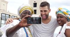 Tourist taking a selfie with a Baiana on Lacerda Elevator, Salvador, Bahia Stock Footage