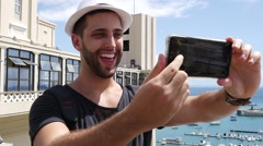 Tourist taking a selfie in Lacerda Elevator, Salvador, Bahia, Brazil Stock Footage