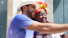 Tourist taking a selfie with a Baiana in Salvador, Brazil Stock Footage