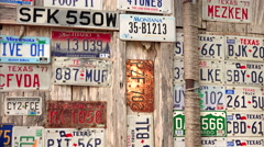Old License Plates on Display in Luckenbach, Texas - stock footage