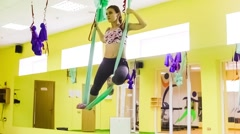 Aerial Yoga  in the air. It is practiced on a soft fabric trapeze - stock footage