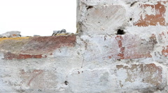 Destroyed red brick wall. Stock Footage
