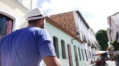 Tourist walking old colonial district (Pelourinho) of Salvador, Brazil Stock Footage
