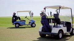 Two golf carts loaded with bags and clubs Stock Footage