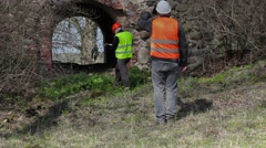Building inspector filming on tablet PC at old ruins before restoration Stock Footage