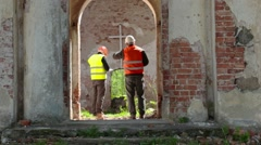 Building inspector take pictures on tablet PC at old church before restoration - stock footage